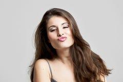 Big kiss. Studio portrait of a beautiful young woman sending a big kiss Stock Photography