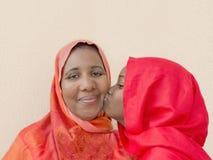 A big kiss on mummy's cheek ! Royalty Free Stock Image