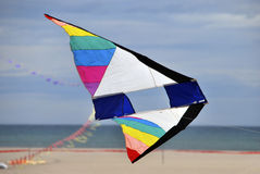 Big kite. A multicolored kite flying in the beach Royalty Free Stock Photography