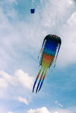 Big kite in the cloudy sky royalty free stock photography