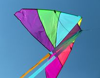 Big kite flying high in the sky blue Stock Images
