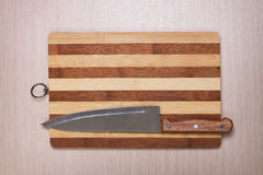 Big knife and breadboard on table Royalty Free Stock Image