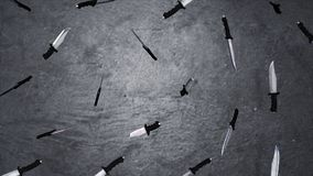 Big knives blade close up on gray background. Animation of the flying knives. The concept of a large number of. Weapons royalty free stock photography