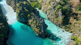 Big lagoon, El Nido, Palawan, Philippines. Aerial view of emerald water, sharp cliffs and coral reefs. unique spot, top. Touristic destination and must-see stock footage