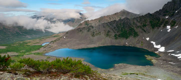 Big Lake. Evening panorama from the mountain lake in the valley and tourist camp Royalty Free Stock Photo