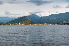 Lake Maggiore, Italy. Piedmont shore with the cities of Intra and Verbania at dawn, illuminated by the sun stock photos