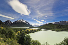 Big lake in patagonia mountains with beautiful clouds Stock Image