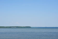 Big lake under the blue sky Stock Photography