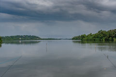Big lake under grey sky in Sri Lanka. Huge lake under grey sky at the small tourist town in Sri Lanka royalty free stock photos