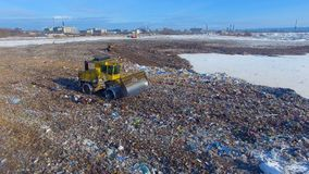 A top view on a contemporary landfill site. A big landfill site on city outskirts as seen from above stock footage