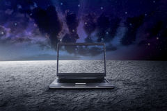Big laptop on the outer space Stock Image
