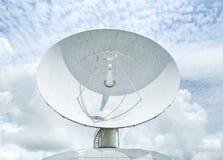 Big large white satellite dishe turn up skyward on blue sky stock photos