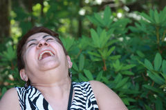Big Laugh. An middle-aged woman in a fit of laughter Royalty Free Stock Photo