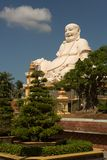Big laughing sitting outdoor Buddha in Vinh Trang Pagoda in South Vietnam royalty free stock image