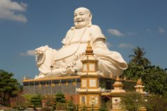 Big laughing sitting outdoor Buddha in Vinh Trang Pagoda in South Vietnam stock photos