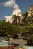 Big laughing sitting outdoor Buddha in Vinh Trang Pagoda in South Vietnam stock image