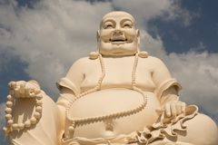 Big laughing sitting outdoor Buddha in Vinh Trang Pagoda in South Vietnam stock images