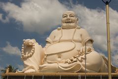 Big laughing sitting outdoor Buddha in Vinh Trang Pagoda in South Vietnam stock photography