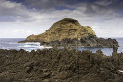 Big lava rock madeira portugal Royalty Free Stock Image