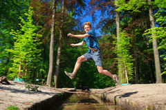 Big leap over the river of life Stock Photos