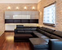 Big leather couch in living room royalty free stock photos