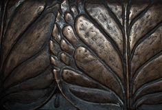 Big leaves close-up macro dark bronze metal relief background.  Royalty Free Stock Photography