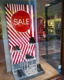 Signs of sale in shop windows of shoe store. Big letters indicate sale in shop windows of shoe store Royalty Free Stock Photos