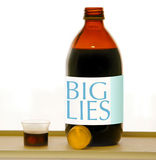 Big lies syrup. Syrup bottle with measure cup, big pharma, deceived trust, business manipulation public opinion, customer opinion Stock Photos