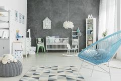Big and light room for a child. Big and light room with grey wall for a child stock photo