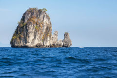 Big limestone island  at coastline in andaman sea Royalty Free Stock Photography
