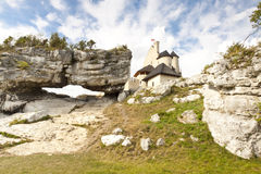 Big limestone rock in background Bobolice castle. Royalty Free Stock Photos