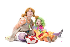 Big and little clown are making silly face. Isolated over white Royalty Free Stock Photography