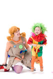 Big and little clown are playing stock images