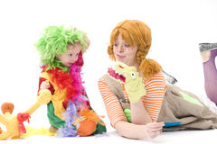 Big and little clown are playing VI. Colorful dressed Mother and daughter playing. Isolated over white Royalty Free Stock Photography