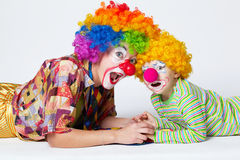 Big and little funny clowns photo Stock Photos