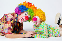 Big and little funny clowns photo stock images