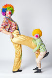 Big and little funny clowns photo Stock Photography