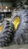 Big and little tires. Tractor tires for heavy machinery royalty free stock image