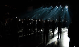 Big Live Music Concert and with Crowd and Lights. Concert hall with spotlights filled people Stock Images