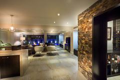 Big living room with a wine cellar. In a luxurious house stock photography