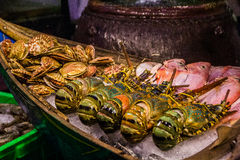 Big lobsters and clamshells in Asian market Royalty Free Stock Photo