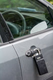 Big lock on a car door. A big lock on a car door handle. Crime concept royalty free stock images