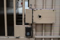 Big lock on the door in prison. Close up, cell, jail, corridor, bar, penitentiary, justice, criminal, old, building, crime, interior, security, metal, prisoner royalty free stock images