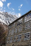 Big lodge house at peak mountains foot Stock Photography