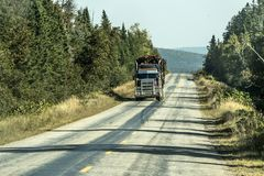 Big Logging truck moving highway wood from harvest field plant Canada ontario quebec. Big Logging truck moving on highway wood from harvest field plant Canada stock images