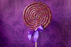 Big lolipop on violet background Royalty Free Stock Photos