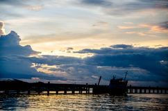 A Big Long Fishing Pier at Sunrise. At thailand Stock Image