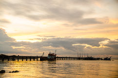 A Big Long Fishing Pier at Sunrise Stock Image