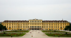Big long yellow palace with gardens. Schönbrunn Palace is a big, baroque architectural monument from Vienna, Austria royalty free stock photo