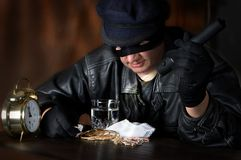 Big Loot. Burglar finding a big loot of diamonds and jewellery Stock Photos